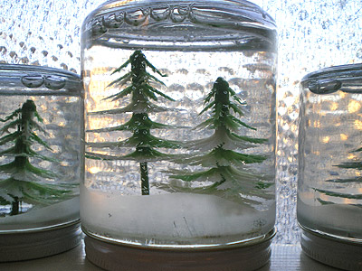 Turn an old jar into an adorable snow globe.