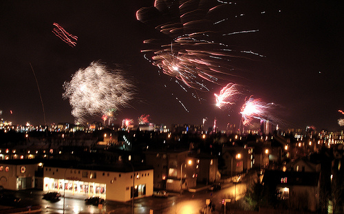 In Reykjavík, a chilly wind blows fireworks across the skyline.  Source:  Flickr User borkur.net