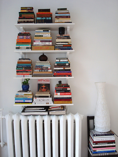 Try stacking books vertically instead of horizontally. It creates a more interesting visual element in a space. Source:  Flickr User jawcey