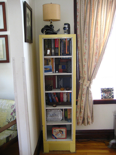 A narrow shelf fits neatly into a cramped corner in this home, and also serves as a cool lunchbox display. Source:  Flickr User back_garage