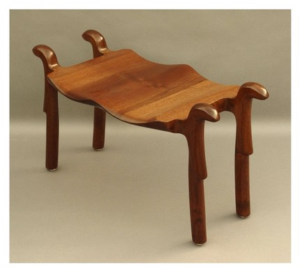 The Black Walnut Wood Seat ($800) is seductively curvy.