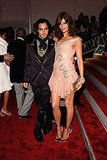 Zac Posen and Helena Christensen in his design