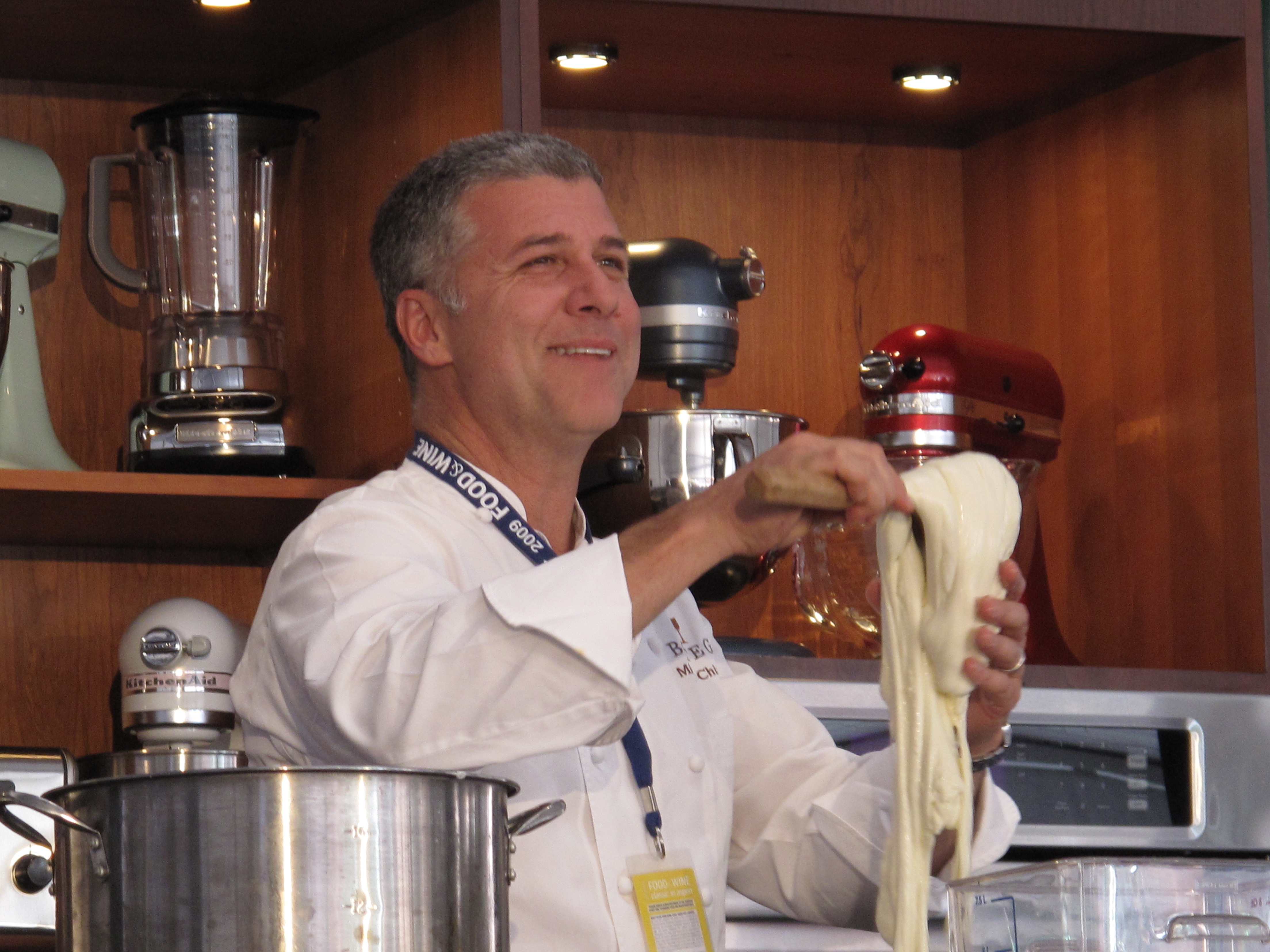 Michael Chiarello pulls fresh mozzarella.