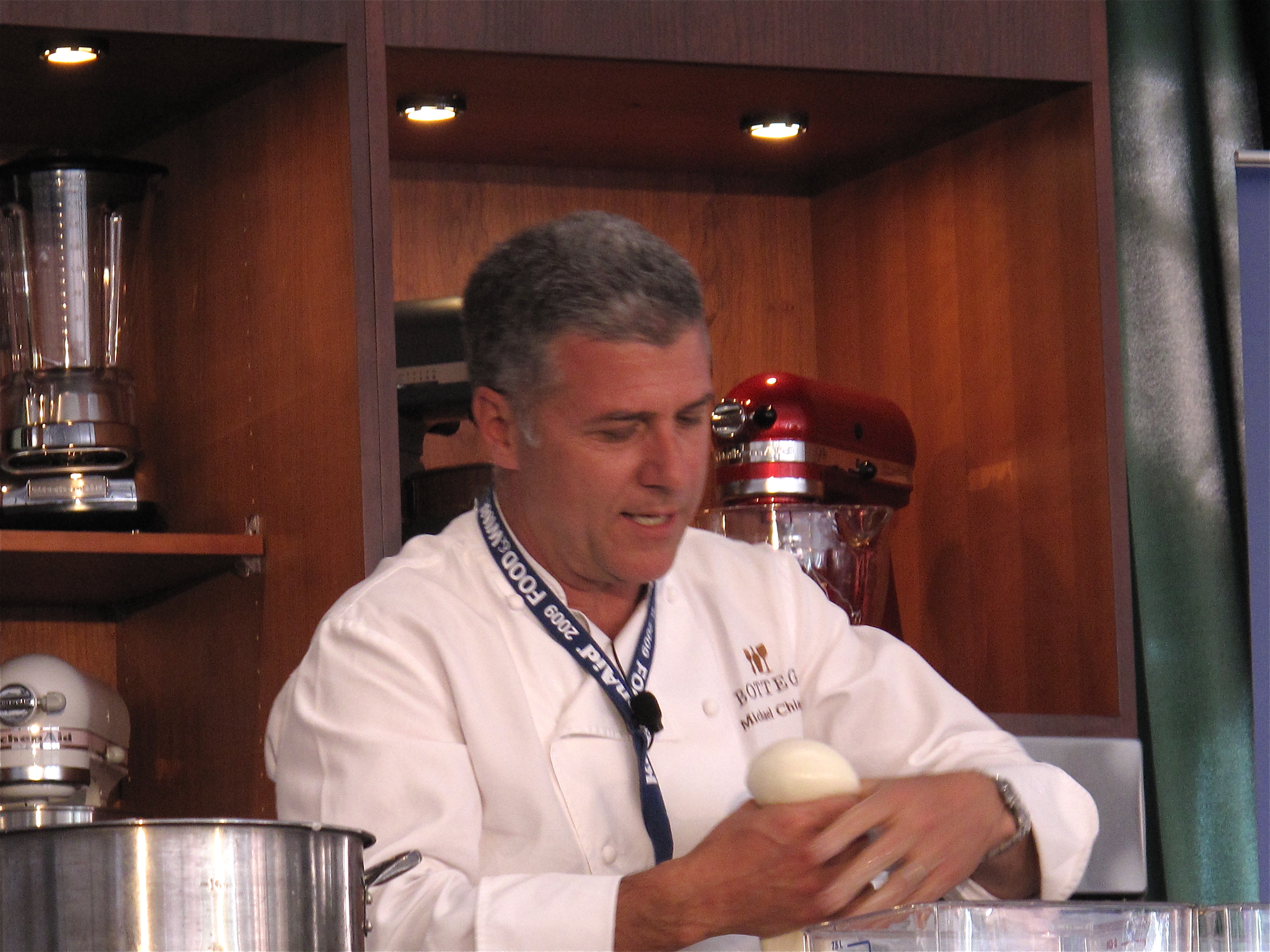 Michael Chiarello making a fresh mozzarella ball.