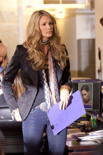 Elle Macpherson, gorgeous as ever, stars as agency exec Claudia.