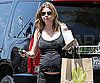 Slide Photo of Ellen Pompeo Wearing Workout Clothes and Picking Up Food
