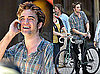 Photos of Robert Pattinson Chatting On an Old School Cell Phone on the NYC Set of Remember Me