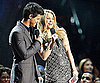 Slide Photo of Taylor Lautner and Shakira at VMAs