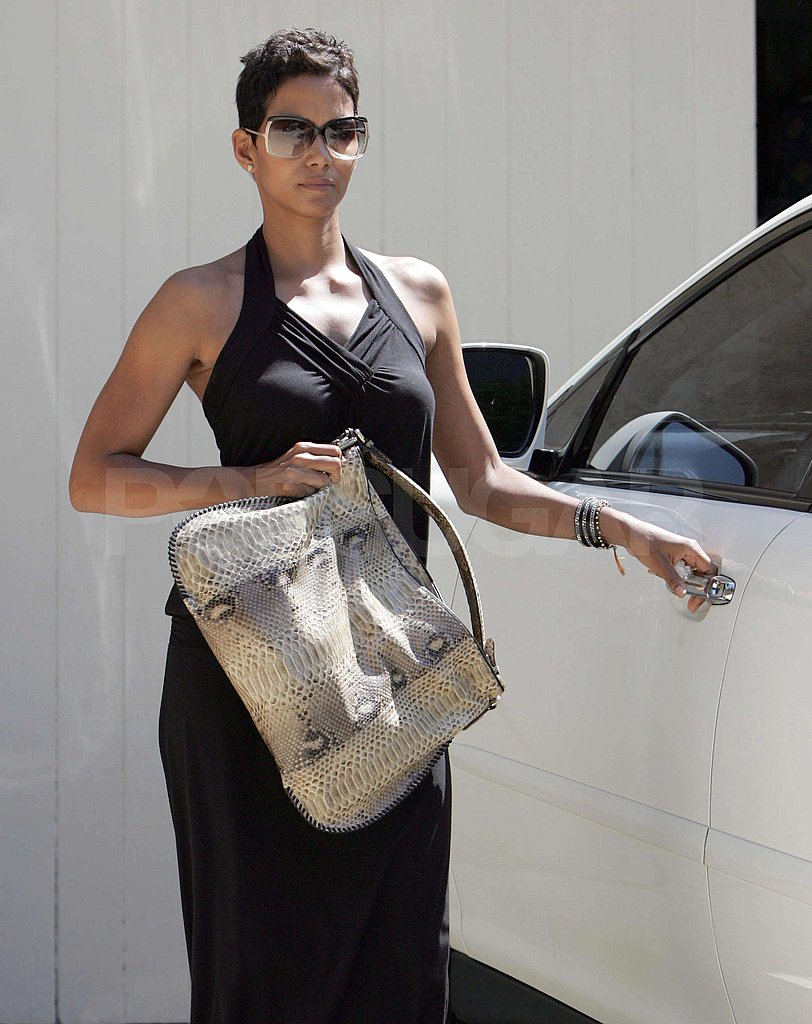 Photos of Halle Holding Purse