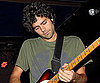 Slide Photo of Adrian Grenier Playing Guitar on Stage