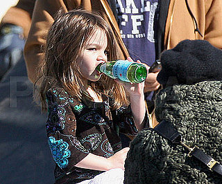 Slide Photo of Suri Cruise Sipping on Pellegrino in Boston