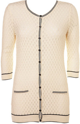 I peeped Olivia Palermo wearing this adorable Preppy Textured Cardigan ($70) the other day.