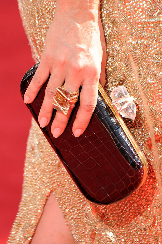Sandra Oh's awesome black croc clutch and jagged rock ring.
