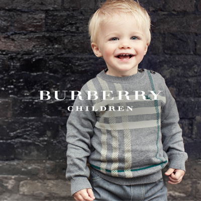 With Fall just around the corner, this 100 percent cotton sweater is a perfect addition to any child's wardrobe. Shown in heather gray with the Burberry check detailing, this is a perfect piece to send your loved one out for a fun day of play!