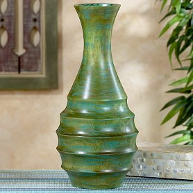 The Novica Green Forests Vase ($39.99) is a close match in shape and color to the original Bond vase.