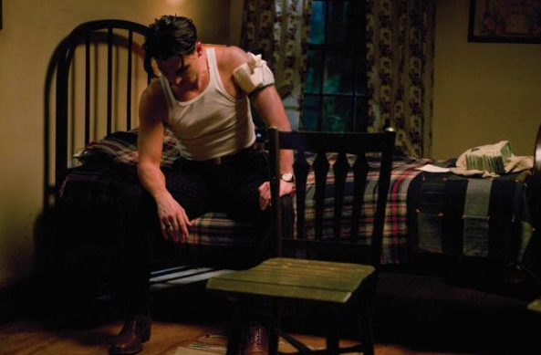 Johnny Depp portrays legendary American gangster John Dillinger in Public Enemies, which is currently in theaters.  While I'd lose the plaid quilt here, I'd absolutely grab the bed frame.  Source