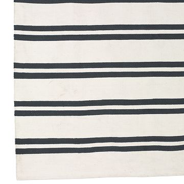 Create a beachy backdrop for your living room by covering your floor with multiples of these Williams-Sonoma Nautical Stripe Rugs (on sale for $119.99-249.99).