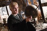 Ugh. I hate that pasty-faced Draco Malfoy. That wand is definitely not up to any good. Still, I am a little distracted by those unusual globes in the background. Source