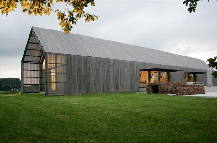 This barn-style house is inspired by the surrounding farm country. Source