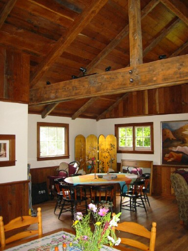 This Mendocino County barn house uses salvaged redwood timbers for the ceiling, floors, and accent woodwork.  Source