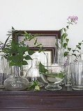 Botanicals on the mantel say Summer instantly. Use clear glass vessels to keep the feel ethereal. 