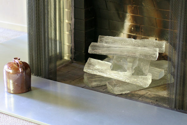 Jeff Benroth makes these very cool glass logs. Originally used in the 2006 Sunset Idea House, they're made by impressing a real piece of wood into a specially bound casting sand, then pouring 2,300 degree F molten glass into the cavity left behind!