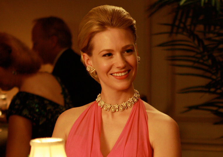 Betty looks stunning in a halter dress and classic pearls.
