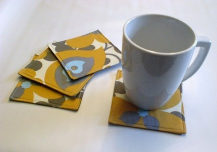 Add some gray and yellow florals to your table with this Coaster Set ($10).