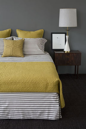 His bedding is the DwellStudio Draper Stripe Set ($308).