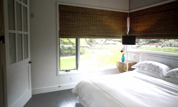 To add organic flair to an otherwise white room, invest in bamboo or other natural fiber blinds.