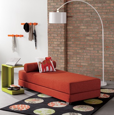 CB2's Lubi Daybed ($749) is minimalist and lovely in this saffron shade. It would look great in a loft apartment.