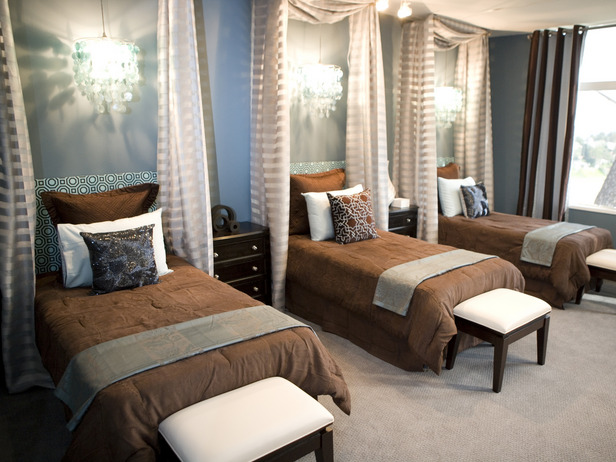 Torie and Jany used curtains to delineate the bed space in this bedroom. Try a similar effect for a room that houses two children. It will give them a sense of privacy.
