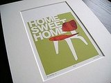 If your home sweet home has midcentury style, this print ($41) by Jenn Ski, featuring a classic Eames chair, is for you.