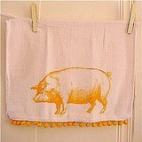 I adore the sunny yellow color of the chubby piggy on this Pig Kitchen Towel ($9), and the cotton pompom edging puts it over the top.