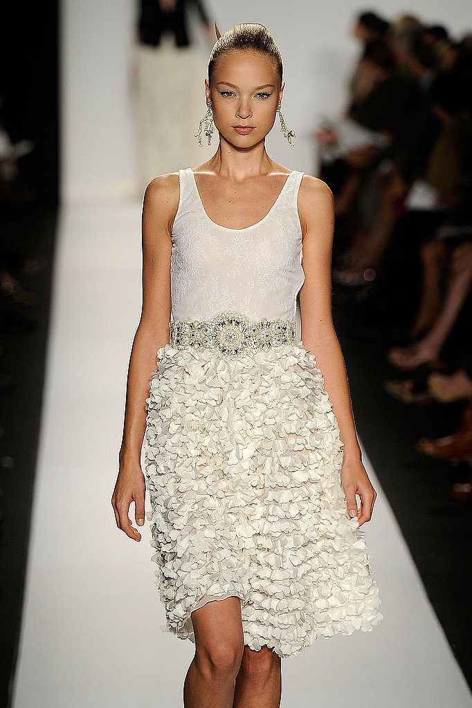 This feminine, ethereal ruffled skirt is balanced by a simple white tank.
