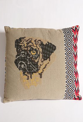Broadcast your pug love with the UO Embroidered Pug Pillow (on sale for $39.99, was $68.00). This embroidered cotton canvas pillow features a cross-stitched pug face at the front with ikat and diamond embroidered pattern strips at the side.