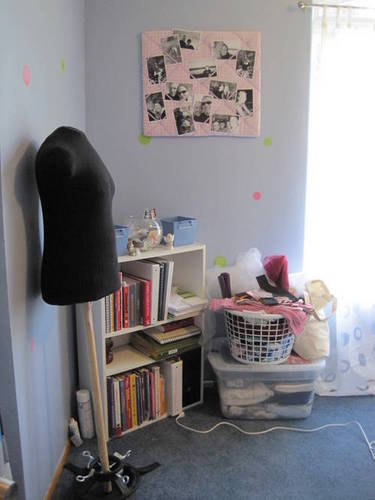"""This side of my room also holds my bookshelf and duct table dummy. I also have my scrap box and basket of fabric (only because I don't really know where to put these yet)."""