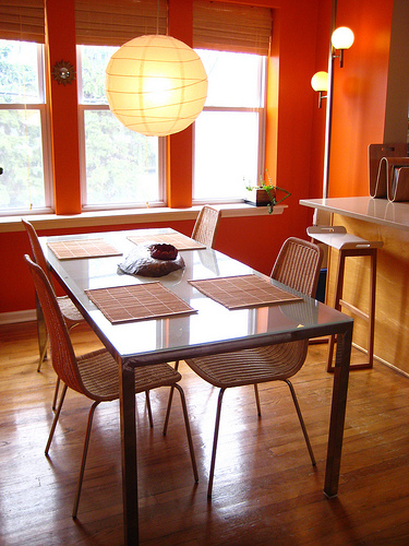 A bright orange kitchen and dining room adds instant energy.  Source:  Flickr User back_garage