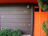 A chocolate brown home gets a fun pop of color thanks to the contrasting orange front door. So fun! Source:  Flickr User A National Acrobat