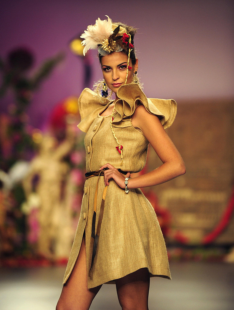 The juxtaposition of this dress's burlap material and its frilly shape is intriguing.