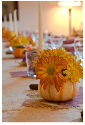 For a formal dinner, hollow out small pumpkins and fill them with autumnal-colored blooms. Source