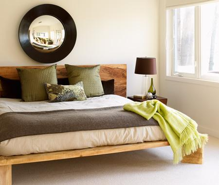 To up the wow factor in a neutral bedroom, pick a brighter shade that echoes the palette of the room.  Source