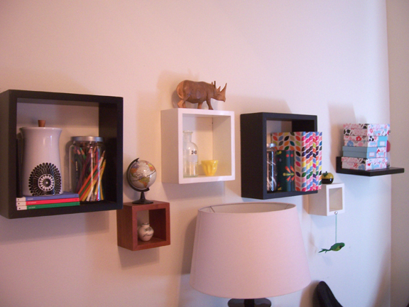 Small wall shelves in a range of sizes create an artful display of knickknacks of all sorts.