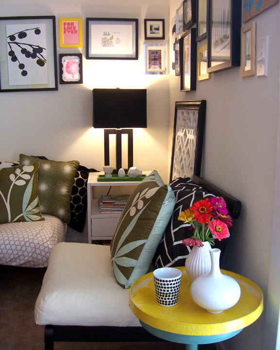 A round tray set on top of a small side table enlarges the table top surface and brings in a pop of yellow!