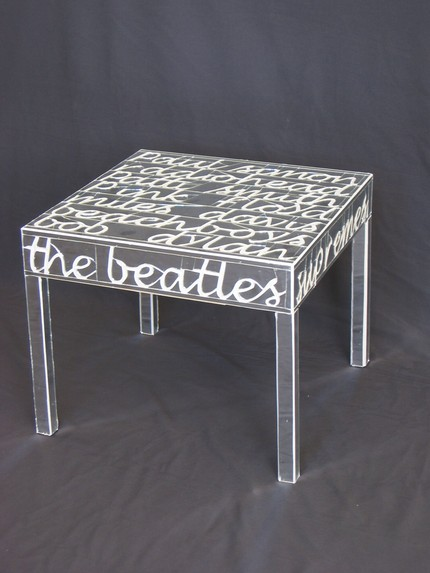 This Beatles Luminary Side Table ($1,200) is made from hand-cut mirrors that have been filled with grout to read off the names of musical greats, including The Beatles.