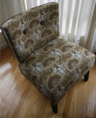 So she upholstered it herself (after taking classes) in a pretty, modern floral fabric.