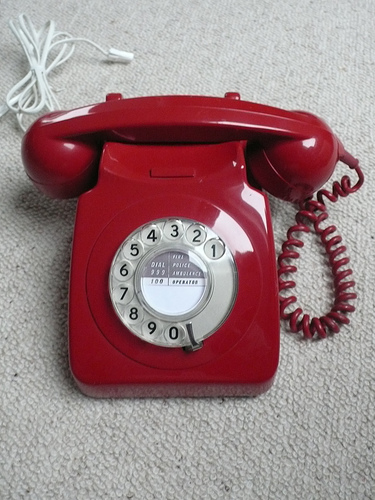 Go for bold, powerful colors with a red rotary phone. Source:  Flickr User psd