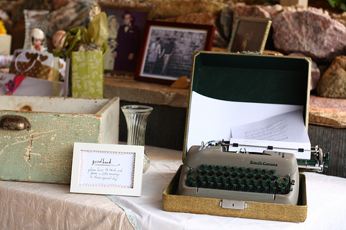 Guests wrote wishes for the couple on a vintage typewriter. Directions were handwritten and posted inside a small frame.
