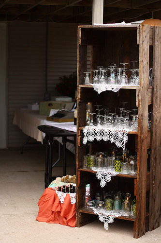 Jamie's dad found this glassware shelf on the side of the road, and brought it home for use as a place to hold stemware for the reception. Beautiful vintage doilies complete the display.