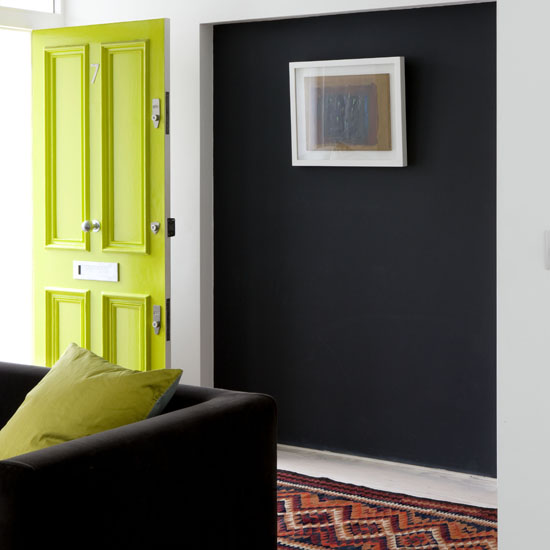 Painting your front door a bright yellow (this one is almost green) gives the exterior of your home a fresh, inviting look. Source